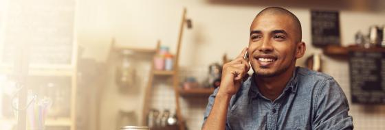 Man on cellular phone smiling