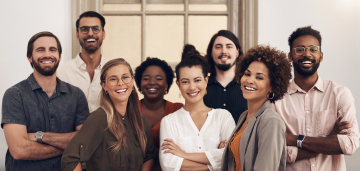 Group of happy employees smiling