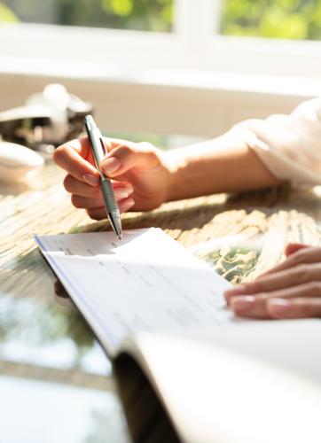 Hand writing a check