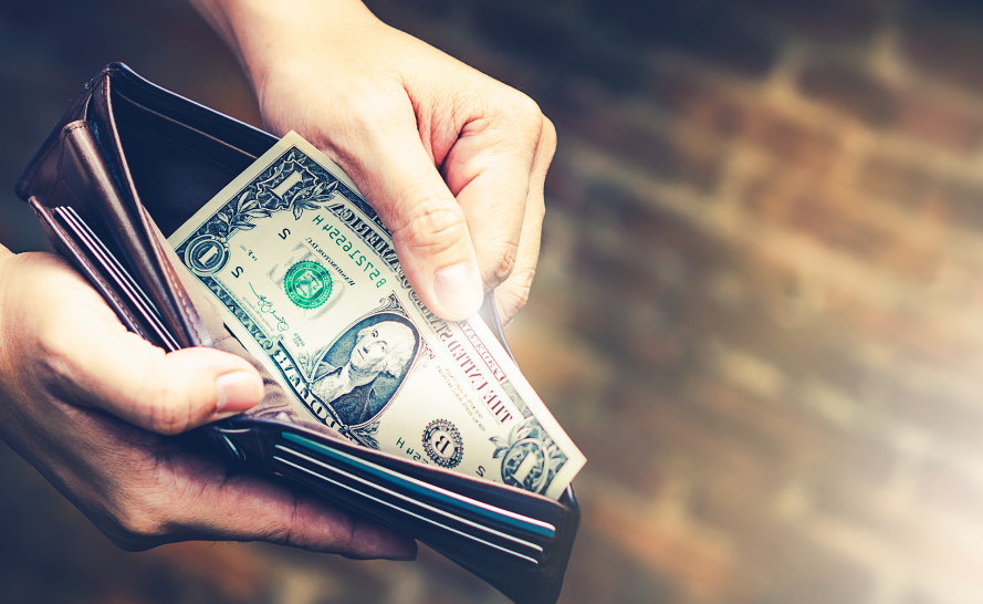 Wallet with dollar bills inside