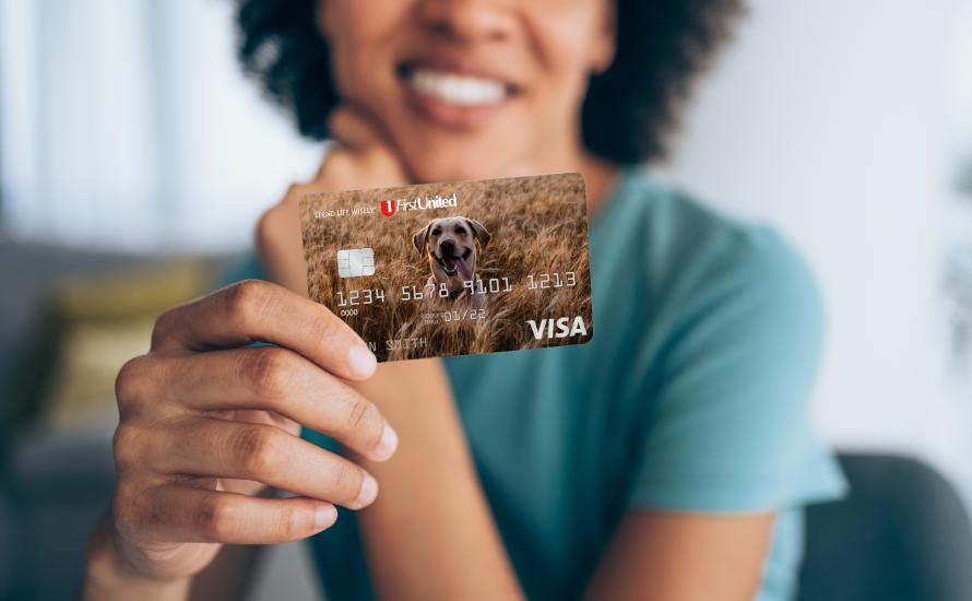 Woman holding a dog design debit card