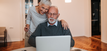Senior man and woman on a laptop