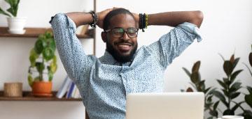 Happy man on his laptop