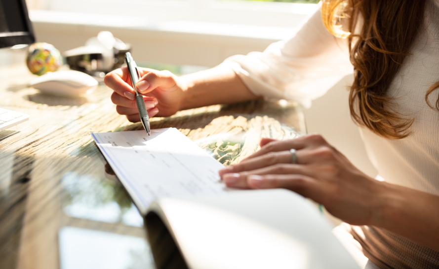 Woman writing in her checkbook