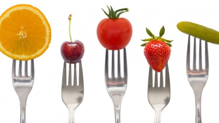 Forks with fruits on it