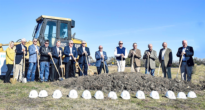 Board of Directors holding shovels at ground breaking of Waxahachie location