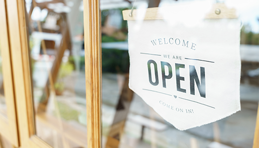 Open sign in window of business