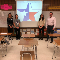 Teachers of Ccass infront of board with Texas Star