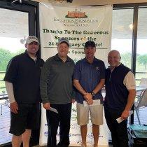 Golfers at golf tournament fundraiser