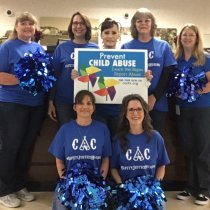 Bankers wearing blue for National Child Abuse Awareness Month