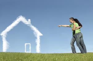 Couple pointing at a home made out of clouds