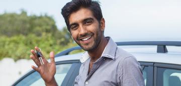 man holding keys to new car