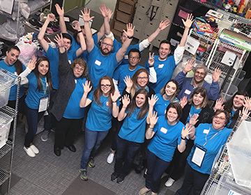 Verity staff celebrating after volunteering