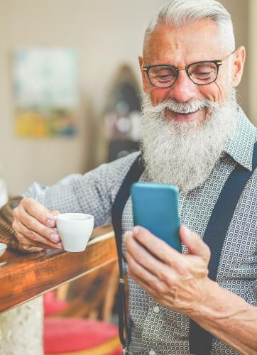 Gentleman with espresso and smartphone