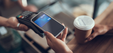 person paying with credit card mobile app