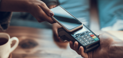 person paying with mobile phone app
